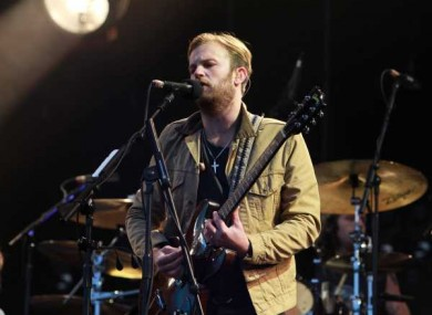 Caleb Followill from the Kings of Leon plays at Slane.