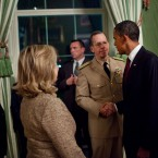Obama shakes hands with Admiral Mike Mullen in the Green Room of the White House following his statement.
