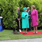Having gotten the formalities out of the way, Her Majesty fulfils a tradition begun by her ancestors: planting a tree in the grounds of the Áras. (Pic: Maxwells)