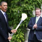 US President Barack Obama gets the wrong end of the stick when Taoiseach Enda Kenny presented him with a hurley on his first State visit to Ireland on Monday.(Image: Maxwells)