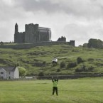The helicopter carrying Queen Elizabeth II and the Duke of Edinburgh is directed into a field beside the Rock of Cashel this morning. (Pic: Eamonn Farrell/Photocall Ireland)