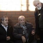 Milan Lugonja (left), Ratko Vucetic (centre) and Stanko Ristic, three of the people accused of helping Mladic evade justice, converse in a Belgrade courtroom in December 2010.<span class=
