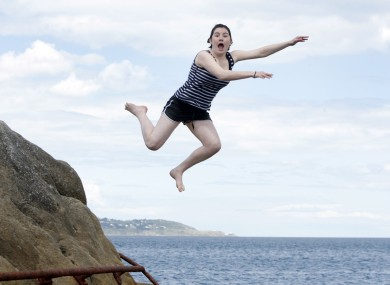 Enjoying the summer sunshine: Danielle Lowrie celebrates finishing her Leaving Cert by going for a dip at the Forty Foot in Dún Laoghaire.