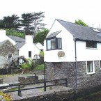 The Mill, a three-bedroom detached house with a separate three-bedroom waterside mews house, in Schull, Co Cork