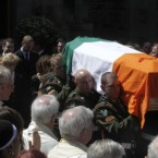The coffin of former Finance Minister Brian Lenihan is carried from St Mochta's Church in Porterstown, Dublin. (Niall Carson/PA Wire)