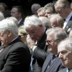 Former TD Noel Treacy (centre) joins other mourners outside St Mochta's Church in Porterstown. (Niall Carson/PA Wire)