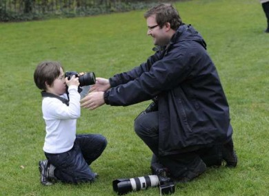 Press photographer Niall Carson pictured here on the other side of the camera recently