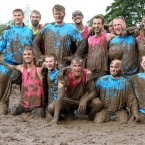 Myriam Vogt 36, from France (top right) and her team Highway to Love which lost to a team called The Mud Company, during the Swamp Soccer World Cup being held at Hunters Hall Park in Edinburgh. Pic: Andrew Milligan/PA Wire