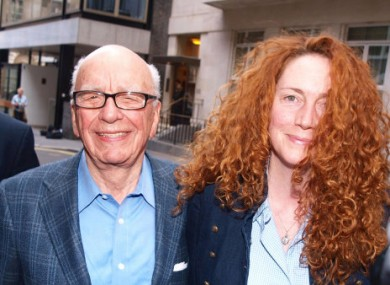 News International chief executive Rebekah Brooks and Rupert Murdoch are seen outside Murdochs London flat.