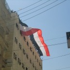 A Syrian flag is displayed in Deir Ezzor as thousands of protestors gather in the city's square after Friday prayers. Although the US and other western powers have condemned the violence being used to crackdown on peaceful protestors, a Libyan-style intervention has been ruled out.
