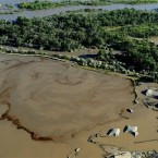 An aerial view of oil swirling in a flooded gravel pit in Lockwood, Montana (AP Photo/The Billings Gazette, Larry Mayer)