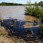 Oil swirls in a flooded gravel pit in Lockwood, Montana (AP Photo/The Billings Gazette,  Casey Page)