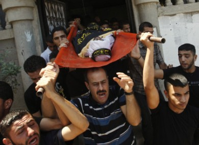 Palestinians carry the body of Islamic Jihad militant Alaa Abu Al Khair, who was killed in an Israeli air strike Thursday, during his funeral in Gaza City, Friday, Aug. 26, 2011.