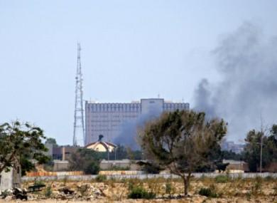 Smoke billows over Muammar Gaddafi's compound.