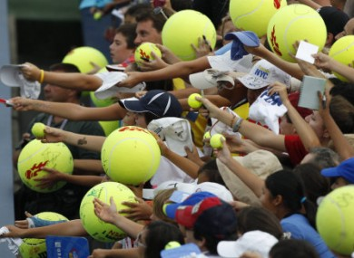 Fans wait for autotgraphs during the U.S. Open tennis tournament in New York.
