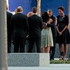 Obama embraces victims' family members as first lady Michelle Obama stands by at the World Trade Centre site. 