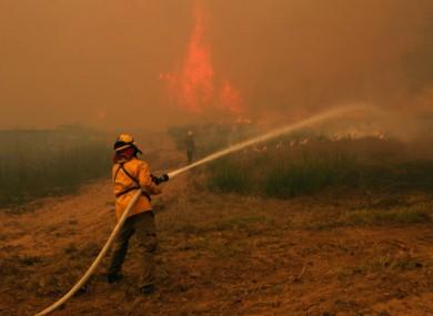 Firefighters tackle a blaze near Smithville, Texas.