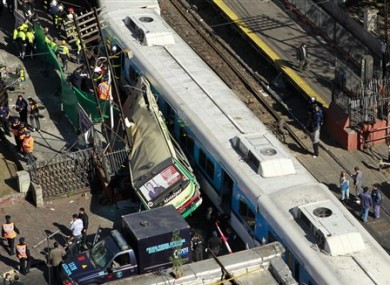 The rush-hour crash involving two trains and a bus killed 11 people and injured hundreds.