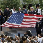 The World Trade Centre Flag is presented as friends and relatives of the victims of 9/11 gather for the ceremony.