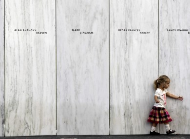 A family member of one of the victims of the crash of United Flight 93 walks along a section of Phase 1 of the permanent National Memorial following its dedication, near the crash site of Flight 93 in Shanksville