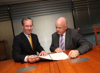 Pictured at the contract signing was Colm O'Neill, CEO BT Ireland, and Niall Barry, CIO Department of Social Protection.