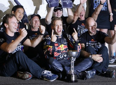 Vettel celebrates with his Red Bull team-mates