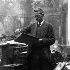 A clerk examines a ledger amid the ruins of the Custom House where records and documentation were destroyed when it burned in May 1921. Image: Mercier Archives