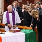 21 May 2011: McAleese bows her head at the coffin of former Taoiseach Dr Garret FitzGerald in Sacred Heart Church in Donnybrook.  Attending funerals as the Head of State is part of the President's role.