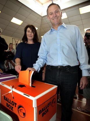 Prime Minister John Key and his wife Bronagh place their votes into a ballot box at Parnell Primary School in Auckland, New Zealand