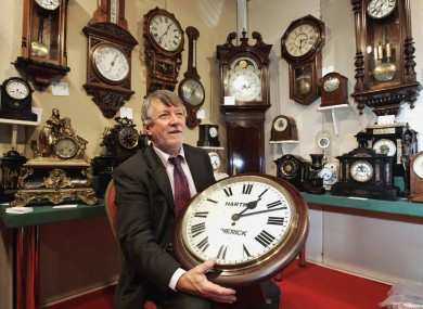 Clockmaker Oliver Walsh from Drogheda, Co. Louth, sits in his area at the Dublin Christmas Antiques Fine Art Fair in the RDS, which runs until the end of the weekend.
