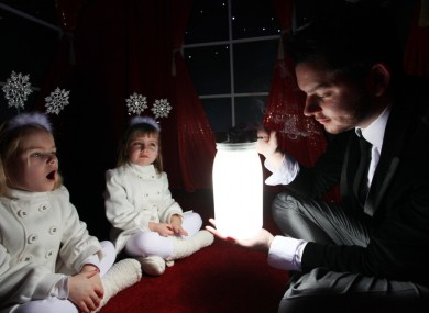 Magician Shane Gillen holds children spellbound at the launch of Santa's Grotto in Dublin's Jervis Street shopping centre this afternoon