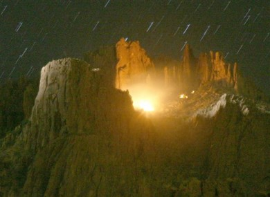 A helicopter search light looks over the scene of an aircraft that crashed in the Superstition Mountains in Apache Junction, on Wednesday, 23 November, 2011.