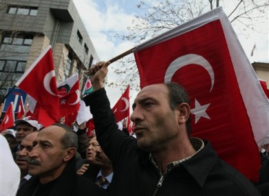 Protesters shout slogans against France and French President Nicolas Sarkozy outside the French Embassy in Ankara, Turkey
