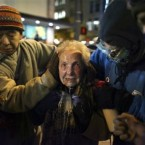 This photograph of 84-year-old Dorli Rainey, pepper-sprayed in the face at the Occupy Seattle anti-capitalist/banking protest struck a chord with similar protests around the world - but also with previously disinterested onlookers. (AP Photo/seattlepi.com/Joshua Trujilo)