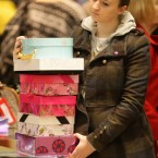 A young woman waits to pay for her items at the Trafford Centre in Manchester.