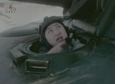 In this undated image made from KRT video, North Korea's new young leader Kim Jong Un appears from a military vehicle at an undisclosed place in North Korea