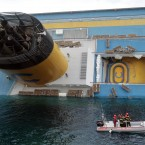 Scuba divers approach the Costa Concordia cruise ship as it leans on its side on Sunday, 15 January. (AP Photo/Gregorio Borgia/PA Images)
