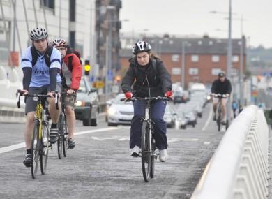 Cyclists on Dublni's Samuel Beckett Bridge