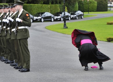 The new Papal Nuncio for Ireland picking up his zucchetto after it blew off at Áras an Uachtaráin on Thursday