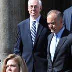 Former New York Comptroller Alan Hevesi, center, exits Manhattan criminal court following his arraignment in New York. Hevesi pleaded guilty to a felony following probe into corruption of the state's pension fund. (AP Photo/ Louis Lanzano)