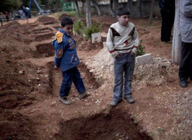 Graves are dug for Free Syrian Army fighters in Idlib. Activists say they can't be buried in graveyards as these are targets of government forces.