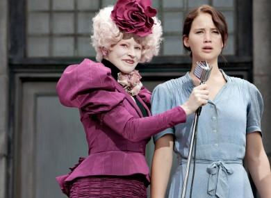 Effie Trinket (played by Elizabeth Banks) and Katniss Everdeen (Jennifer Lawrence) in The Hunger Games