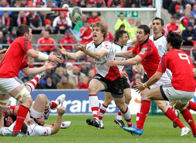 Andrew Trimble keeps his eye on the ball under pressure from Peter O'Mahony and Conor Murray