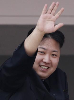 North Korean leader Kim Jong Un waves from a balcony