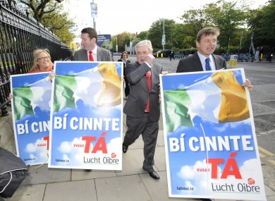 Tanaiste Eamon Gilmore tries to get first past the post(er).