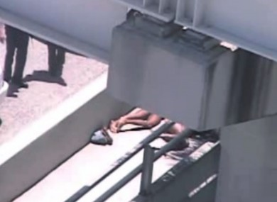 The legs of the naked man (second from the right) who was shot dead by police officers on the ramp in Miami