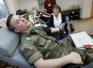 Irish soldier giving blood at an appeal in 2010