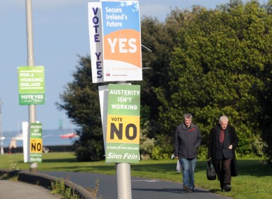 There's just no escaping the posters: walkers in north Dublin yesterday