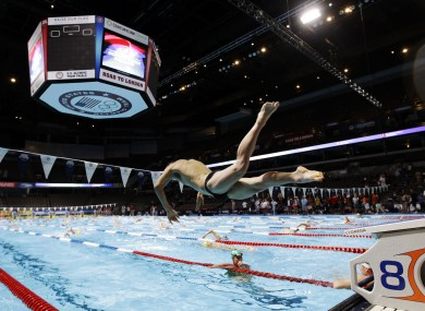 A swimmer dives during practice at the US Olympic swimming trials in Nebraska earlier today