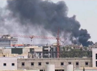 In this image taken from AP video, thick black smoke rises over the Damascus skyline after a powerful explosion rocked the Syrian capital yesterday.